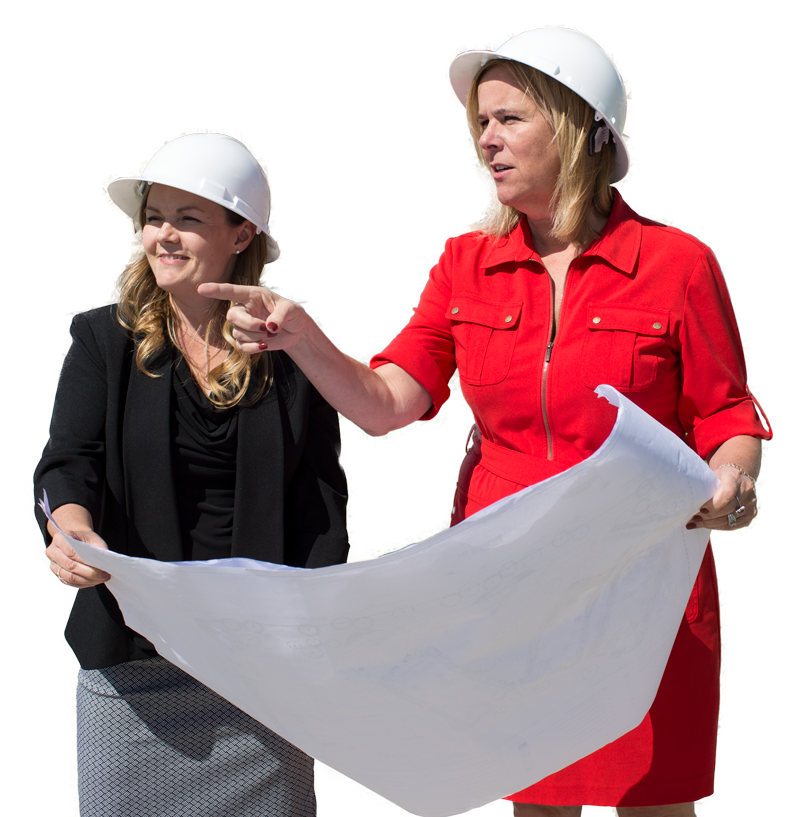 two ladies looking at blue print or floor plan of a house home pointing out to the distance wearing white hard hats looking for resouces