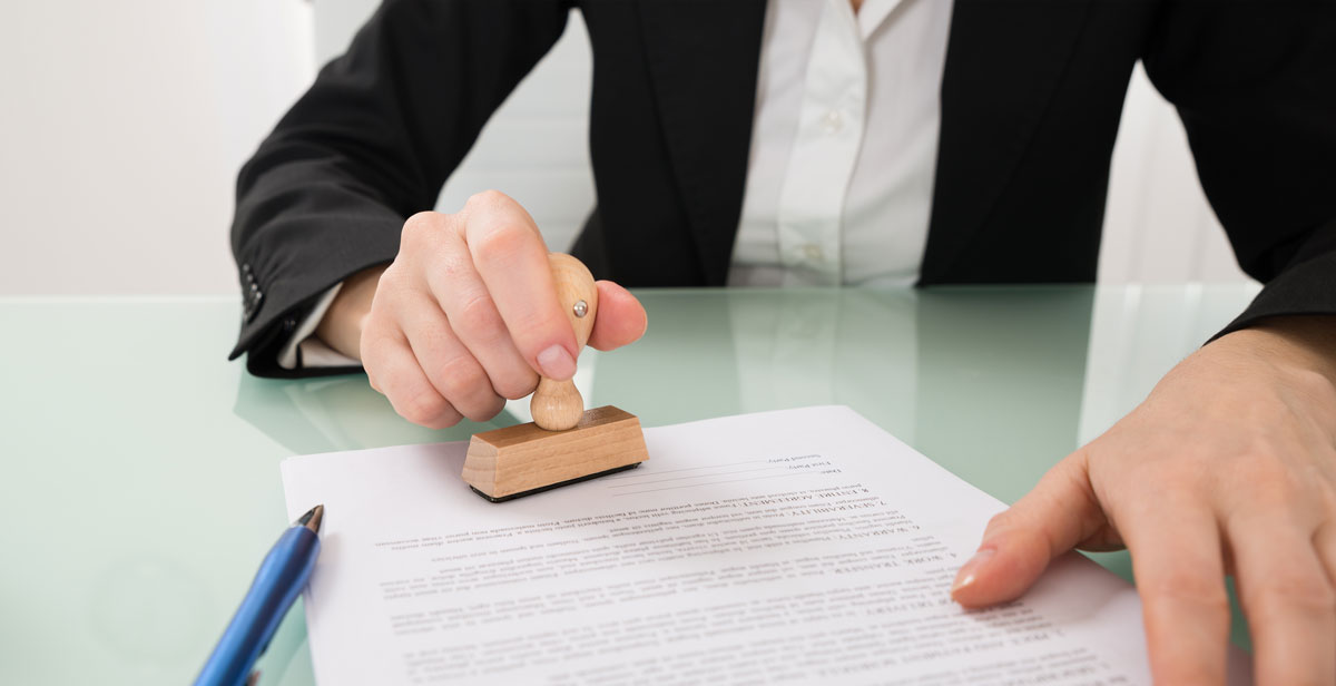 person stamping a document for approval property modifications must do