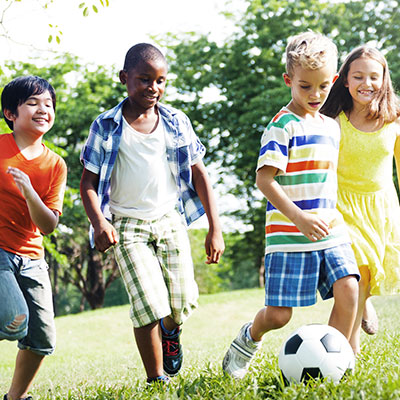 kids playing soccer neighborhood management lifestyle activity